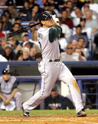 BRONX, NY - JUNE 20:  Jorge Cantu #3 of the Tampa Bay Devil Rays hits an RBI double in the sixth inning scoring teammate Julio Lugo against the New York Yankees on June 20, 2005 at Yankee Stadium in the Bronx borough of New York City. The Devil Rays ended