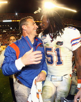 MIAMI - JANUARY 08:  Head coach Urban Meyer of the Florida Gators celebrates with Brandon Spikes #51 their win over the Oklahoma Sooners after the FedEx BCS National Championship Game at Dolphin Stadium on January 8, 2009 in Miami, Florida.  (Photo by Don