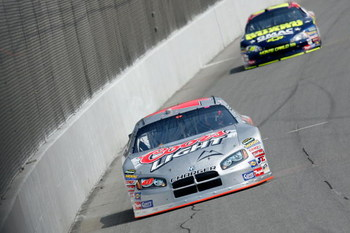BROOKLYN, MI - JUNE 16:  David Stremme, driver of the #40 Coors Light Dodge, leads Casey Mears, driver of the #25 National Guard/GMAC Chevrolet, during practice for the NASCAR Nextel Cup Series Citizens Bank 400 at Michigan International Speedway on June