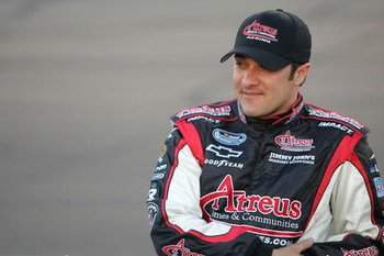 AVONDALE, AZ - APRIL 11:  David Stremme, driver of the #64 Arteus Homes & Communities Chevrolet, stands on the grid prior to the NASCAR Nationwide Series Bashas' Supermarkets 200 at Phoenix International Raceway on April 11, 2008 in Avondale, Arizona.  (P