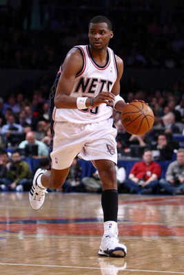 NEW YORK - MARCH 18:  Keyon Dooling #55 of the New Jersey Nets dribbles against the New York Knicks at Madison Square Garden March 18, 2009 in New York City. NOTE TO USER: User expressly acknowledges and agrees that, by downloading and/or using this Photo
