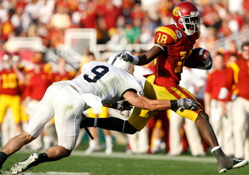PASADENA, CA - JANUARY 01:  Damian Williams #18 of the USC Trojans runs for yardage past Mark Rubin #9 of the Penn State Nittany Lions during the 95th Rose Bowl Game presented by Citi on January 1, 2009 at the Rose Bowl in Pasadena, California.  (Photo by