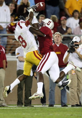 STANFORD, CA - NOVEMBER 15:  Wopamo Osaisai #6 of the Stanford Cardinals breaks up a pass to Ronald Johnson #8 of USC Trojans at Stanford Stadium on November 15, 2008 in Stanford, California.  (Photo by Jed Jacobsohn/Getty Images)