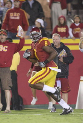 LOS ANGELES - OCTOBER 4:  David Ausberry of the USC Trojans runs after a catch for a 59 yard touchdown against the Oregon Ducks in the fourth quarter of the game on October 4, 2008 at the Los Angeles Memorial Coliseum in Los Angeles, California.  USC won