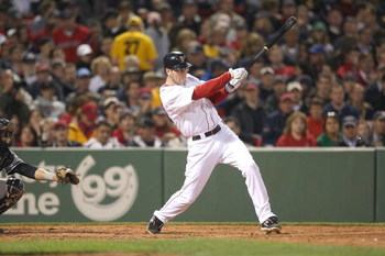 BOSTON - JUNE 11: Jason Bay #44 of the Boston Red Sox makes contact against the New York Yankees at Fenway Park on June 11, 2009 in Boston, Massachusetts.  (Photo by Jim Rogash/Getty Images)