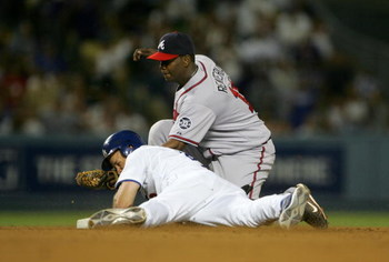 LOS ANGELES, CA - JULY 03:  Jeff Kent #12 of the Los Angeles Dodgers is safe at second with a double ahead of the tag by shortstop Edgar Renteria #11 of the Atlanta Braves in the seventh inning on July 3, 2007 at Dodger Stadiium in Los Angeles, California