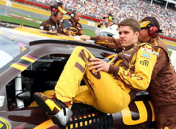 CONCORD, NC - MAY 25:  David Ragan, driver of the #6 UPS Ford, climbs into his car on the grid prior to the NASCAR Sprint Cup Series Coca-Cola 600 on May 25, 2009 at Lowe's Motor Speedway in Concord, North Carolina.  (Photo by Scott Halleran/Getty Images