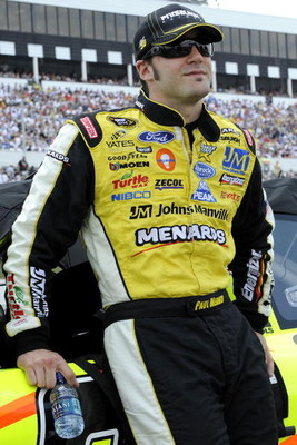 LONG POND, PA - JUNE 07: Paul Menard, driver of the #96 Pittsburgh Paints/Menards Ford stands on pit road before the start of  the NASCAR Sprint Cup Series Pocono 500 on June 7, 2009 at Pocono Raceway in Long Pond, Pennsylvania.  (Photo by John Harrelson/