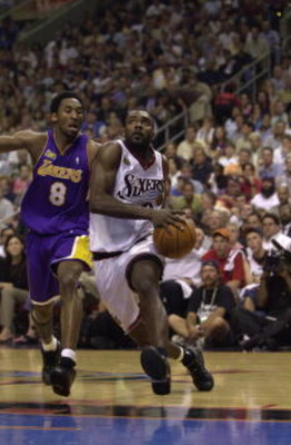 15 Jun 2001:  Aaron McKie #8 of the Philadelphia 76ers drives to the basket against the defense of Kobe Bryant #8 of the Los Angeles Lakers in game five of the NBA Finals at the First Union Center in Philadelphia, Pennsylvania.  The Lakers won 108-86 to t