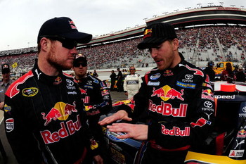 BRISTOL, TN - MARCH 21:  Scott Speed (R), driver of the #99 Red Bull Toyota, talks with Cup teammate Brian Vickers, driver of the #83 Red Bull Toyota, on the grid prior to the start of the NASCAR Nationwide Series Scotts Turf Builder 300 at Bristol Motor