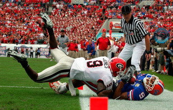 JACKSONVILLE, FL - OCTOBER 27:  Wide receiver Louis Murphy #9 of the Florida Gators makes a touchdown pass reception against Reshad Jones #9 of the Georgia Bulldogs at Jacksonville Municipal Stadium on October 27, 2007 in Jacksonville, Florida.  (Photo by