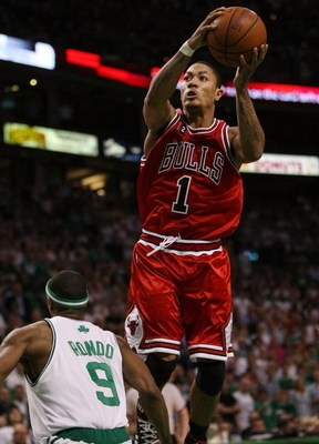BOSTON - APRIL 28:  Derrick Rose #1 of the Chicago Bulls nabs the rebound as Rajon Rondo #9 of the Boston Celtics defends in Game Five of the Eastern Conference Quarterfinals during the 2009 NBA Playoffs at TD Banknorth Garden on April 28, 2009 in Boston,