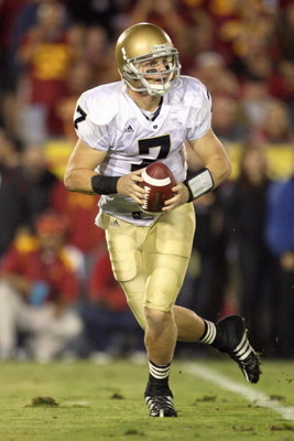 LOS ANGELES - NOVEMBER 29:  Quarterback Jimmy Clausen #7 of the Notre Dame Fighting Irish moves back to pass the ball during the game against the USC Trojans at the Memorial Coliseum on November 29, 2008 in Los Angeles, California. (Photo by: Jeff Gross/G