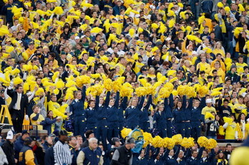 ANN ARBOR, MI - OCTOBER 25:  Fans of the Michigan Wolverines cheer from the stands during the game against the Michigan State Spartans on October 25, 2008 at Michigan Stadium in Ann Arbor, Michigan. Michigan State won the game 35-21. (Photo by Gregory Sha