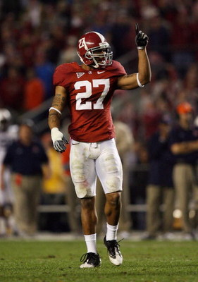 TUSCALOOSA, AL - NOVEMBER 29:  Defensive back Justin Woodall #27 of the Alabama Crimson Tide celebrates after making a stop in the fourth quarter against the Auburn Tigers at Bryant-Denny Stadium on November 29, 2008 in Tuscaloosa, Alabama. Alabama defeat