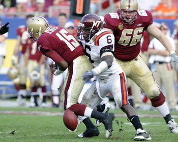 TAMPA, FL - DECEMBER 6: Defensive end Jason Worilds #6 of the Virginia Tech Hokies forces a fumble by quarterback Dominique Davis #15 of the Boston College Eagles in the 2008 ACC Football Championship game at Raymond James Stadium on December 6, 2008 in T