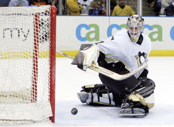 UNIONDALE, NY - APRIL 15:  Sebastien Caron #31 of the Pittsburgh Penguins watches the puck after making a save against the New York Islanders on April 15, 2006 at the Nassau Coliseum in Uniondale, New York. The Isles defeated the Pens 5-4 after a shootout