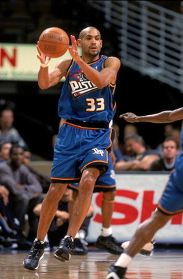 Grant Hill #33 of the Detroit Pistons passes the ball during a game against the Denver Nuggets at the Pepsi Center in Denver, Colorado. The Nuggets defeated the Pistons 100-96.