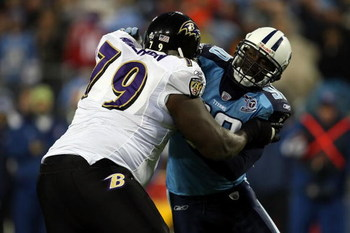 NASHVILLE, TN - JANUARY 10:  Defensive end Jevon Kearse #90 of the Tennessee Titans is blocked by tackle Willie Anderson #79 of the Baltimore Ravens during the AFC Divisional Playoff Game on January 10, 2009 at LP Field in Nashville, Tennessee.  (Photo by