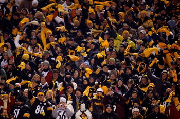 PITTSBURGH - JANUARY 18:  Fans of the Pittsburgh Steelers support their team against the Baltimore Ravens during the AFC Championship game on January 18, 2009 at Heinz Field in Pittsburgh, Pennsylvania.  (Photo by Streeter Lecka/Getty Images)