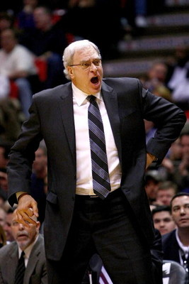 EAST RUTHERFORD, NJ - MARCH 27: Head coach Phil Jackson of the Los Angeles Lakers screams instructions against the New Jersey Nets during their game on March 27, 2009 at the Izod Center in East Rutherford, New Jersey. NOTE TO USER: User expressly acknowle