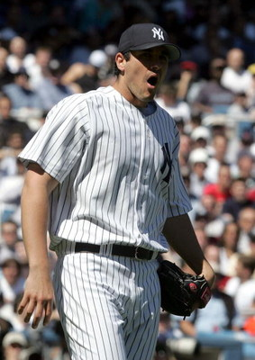 BRONX, NY - APRIL 10:  Carl Pavano #45 of the New York Yankees reacts after being hit in the head on a line drive hit by Melvin Mora of the Baltimore Orioles during their game on April 10, 2005 at Yankee Stadium in the Bronx borough of New York City.  (Ph