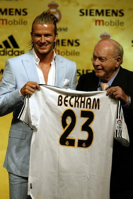 MADRID - JULY 2:  David Beckham is given his new shirt and number by Real Madrid legend and greatest player of them all Alfredo Di Stefano at the Real Madrid press conference announcing his signing to Real Madrid on July 2, 2003 at the Pabellon Raimundo S