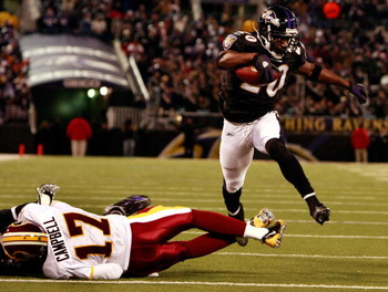 BALTIMORE - DECEMBER 07:  Safety Ed Reed #20 of the Baltimore Ravens returns a fumble for a touchdown as he leaps over quarterback Jason Campbell #17 of the Washington Redskins December 7, 2008 at M&T Bank Stadium in Baltimore, Maryland.  (Photo by Win Mc