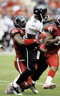 HOUSTON - SEPTEMBER 27:  Quarterback David Garrard #9 of the Jacksonville Jaguars is sacked by defensive end Mario Williams #90 of the Houston Texans at Reliant Stadium on September 27, 2009 in Houston, Texas.  (Photo by Bob Levey/Getty Images)