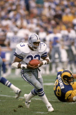 ANAHEIM, CA - JANUARY 4:  Running back Tony Dorsett #33 of the Dallas Cowboys rushes for yards during a 1985 NFC Divisional Playoff game against the Los Angeles Rams at Anaheim Stadium on January 4, 1996 in Anaheim, California.  The Rams won 20-0.  (Photo