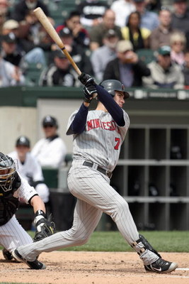 CHICAGO - MAY 08:  Joe Mauer #7 of the Minnesota Twins swings at a pitch during the game against the Chicago White Sox on May 8, 2008 at U.S. Cellular Field in Chicago, Illinois. (Photo by Jonathan Daniel/Getty Images)