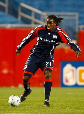 FOXBOROUGH, MA - APRIL 4:  Shalrie Joseph #21 of the New England Revolution battles against the FC Dallas at Gillette Stadium on April 4, 2009 in Foxborough, Massachusetts.  (Photo by Jim Rogash/Getty Images)