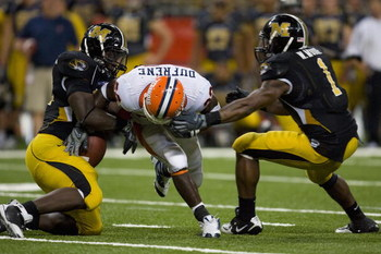ST. LOUIS, MO - AUGUST 30:   Daniel Dufrene #22 of the University of Illinois Fighting Illini has the ball stripped by Sean Witherspoon #12 of the University of Missouri Tigers during the State Farm Arch Rivalry game at the Edward Jones Dome on August 30,
