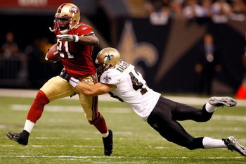 NEW ORLEANS - SEPTEMBER 28:  Frank Gore #21 of the San Francisco 49ers is tackled by Kevin Kaesviharn #43 of the New Orleans Saints on September 28 2008 at the Superdome in New Orleans, Louisiana.  The Saints defeated the 49ers 31-17.  (Photo by Chris Gra
