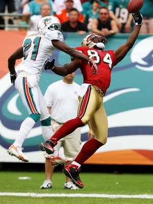 MIAMI - DECEMBER 14:  Cornerback Andre Goodman #21 of the Miami Dolphins tips the ball away from wide receiver Josh Morgan #84 of the San Francisco 49ers at Dolphin Stadium on December 14, 2008 in Miami, Florida.  (Photo by Doug Benc/Getty Images)