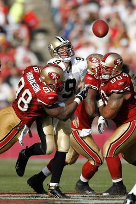 SAN FRANCISCO - OCTOBER 28:  Quarterback Drew Brees #9 of the New Orleans Saints is hit as he throws a pass by linebacker Parys Haralson #98 of the San Francisco 49ers during a game at Monster Park October 28, 2007 in San Francisco, California. New Orlean