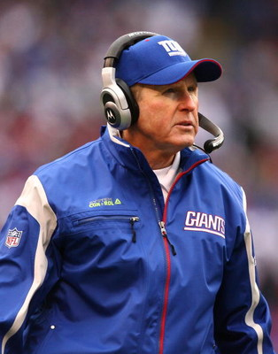 EAST RUTHERFORD, NJ - NOVEMBER 16:  Tom Coughlin, Head Coach of the New York Giants looks on against the Baltimore Ravens during their game on November 16, 2008 at Giants Stadium in East Rutherford, New Jersey.  (Photo by Al Bello/Getty Images)