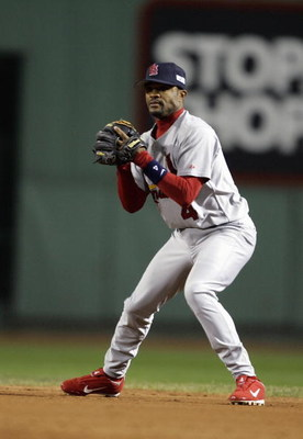 BOSTON - OCTOBER 23:  Tony Womack #4 of the St. Louis Cardinals fields against the Boston Red Sox during game one of the 2004 World Series on October 23, 2004 at Fenway Park in Boston, Massachusetts. (Photo by Elsa/Getty Images)