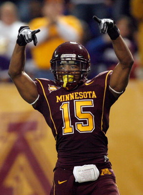 MINNEAPOLIS - NOVEMBER 01: Traye Simmons #15 of the Minnesota Golden Gophers celebrates his interception for a touchdown for a 14-10 lead over the Northwestern Wildcats during the second quarter at the Hubert H.Humphrey Metrodome on November 1, 2008 in Mi