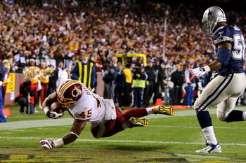 LANDOVER, MD - NOVEMBER 16:  Mike Sellers #45 of the Washington Redskins scores a touchdown in the first quarter against Bradie James #56 of the Dallas Cowboys during their game on November 16, 2008 at FedEx Field in Landover, Maryland.  (Photo by Jim McI