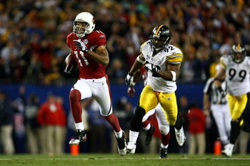 TAMPA, FL - FEBRUARY 01:  Wide receiver Larry Fitzgerald #11 of the Arizona Cardinals scores a 64-yard touchdown reception in the fourth quarter against James Harrison #92 of the Pittsburgh Steelers during Super Bowl XLIII on February 1, 2009 at Raymond J