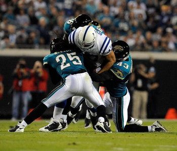 JACKSONVILLE, FL - DECEMBER 18:  Gijon Robinson #47 of the Indianapolis Colts is tackled by Reggie Nelson #25 and Gerald Sensabaugh #43 of the Jacksonville Jaguars during the game at Jacksonville Municipal Stadium on December 18, 2008 in Jacksonville, Flo