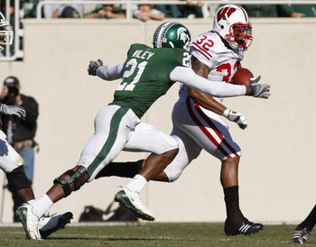 EAST LANSING, MI - NOVEMBER 01: John Clay #32 of the Wisconsin Badgers tries to get around the tackle of Otis Wiley #21 of the Michigan State Spartans during a second quarter run on November 1, 2008 at Spartan Stadium in East Lansing, Michigan.  (Photo by