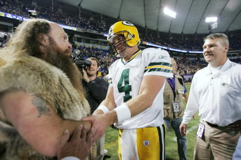 MINNEAPOLIS - NOVEMBER 12:  Quarterback Brett Favre #4 of the Green Bay Packers greets the Minnesota Vikings mascot Ragnar the Viking following the game on November 12, 2006 at the Metrodome in Minneapolis, Minnesota. The Packers defeated the Vikings 23-1