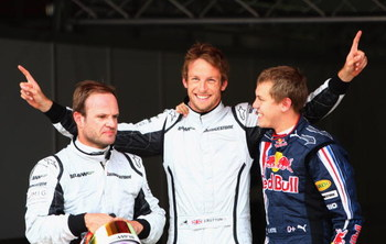 BARCELONA, SPAIN - MAY 09:  (L-R) Third placed Rubens Barrichello of Brazil and Brawn GP, pole sitter Jenson Button of Great Britain and Brawn GP and second placed Sebastian Vettel of Germany and Red Bull Racing celebrate in parc ferem following qualifyin