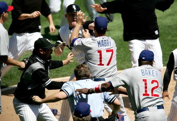 CHICAGO - MAY 20:  Manager Ozzie Guillen #13 of the Chicago White Sox, manager Dusty Baker #12 of the Chicago Cubs and home plate umpire Greg Gibson #53 try to break up a fight involing John Mabry #17 of the Cubs and Brian Anderson #44 of the White Sox on