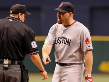 ST. PETERSBURG, FL - MAY 3: Infielder Kevin Youkilis #20 of the Boston Red Sox argues that an infield ball was fair against the Tampa Bay Rays May 3, 2009 at Tropicana Field in St. Petersburg, Florida. (Photo by Al Messerschmidt/Getty Images)
