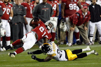 TAMPA, FL - FEBRUARY 01:  Wide receiver Anquan Boldin #81 of the Arizona Cardinals makes a reception against Bryant McFadden #20 of the Pittsburgh Steelers during Super Bowl XLIII on February 1, 2009 at Raymond James Stadium in Tampa, Florida.  (Photo by