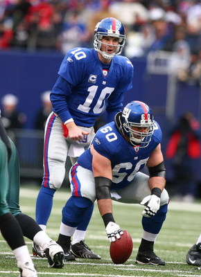 EAST RUTHERFORD, NJ - DECEMBER 07:  Eli Manning #10 and Shaun O'Hara #60 of the New York Giants line up for a play against  the Philadelphia Eagles during their game on December 7, 2008 at Giants Stadium in East Rutherford, New Jersey.  (Photo by Al Bello