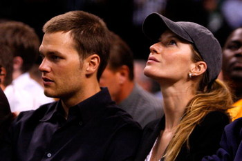 BOSTON - MAY 22:  Tom Brady of the New England Patriots and Giselle Bundchen watch as the Detroit Pistons play against the Boston Celtics during Game Two of the 2008 NBA Eastern Conference finals at the TD Banknorth Garden on May 22, 2008 in Boston, Massa